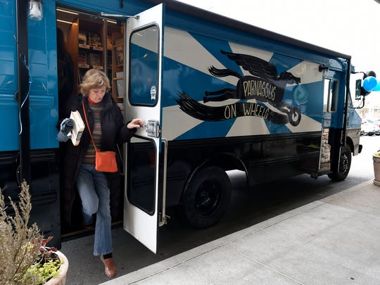 Madge Franklin steps off Pegasus, the bookmobile for