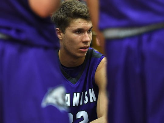 Spanish Springs' Jalen Townsell listens to the coach during a time-out during a recent game against McQueen on Jan. 9, 2018.