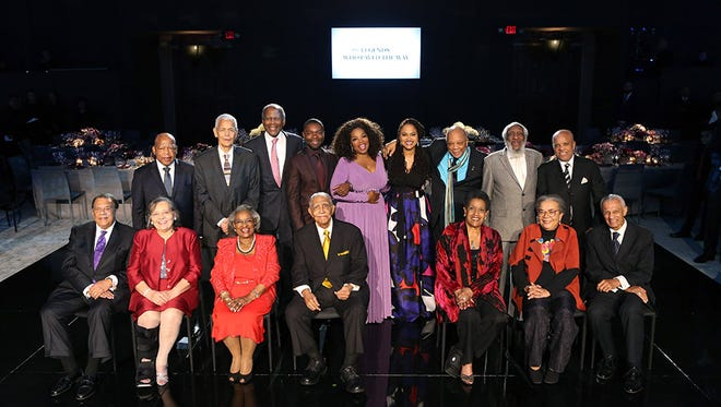 "Opray Winfrey poses with the legends of the civil rights movement, plus the director and star of the new film, ""Selma."""