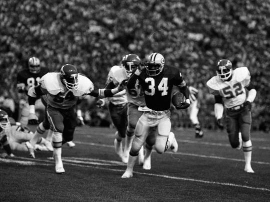 Green Bay Packers running back Terdell Middleton is chased by Kansas City Chiefs linebackers Jimbo Elrod (54) and Dave Rozumek (55), defensive end Art Still (67) and linebacker Tom Howard (52) during a preseason game at Lambeau Field on Aug. 5, 1978. The Packers lost 17-14.