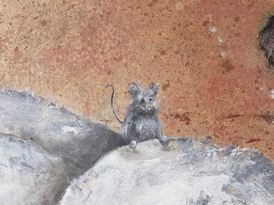 A mouse painted on the Christmas creche was the idea of a St. Teresa of Calcutta parishioner.