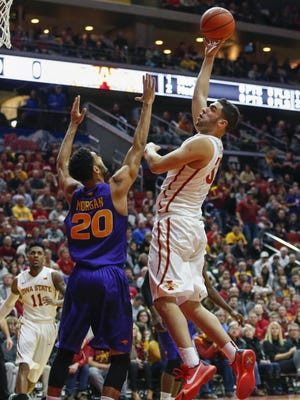 Iowa State senior Georges Niang hooks a shot over UNI's Jeremy Morgan on Saturday, December 19, 2015, at Wells Fargo Arena in Des Moines.