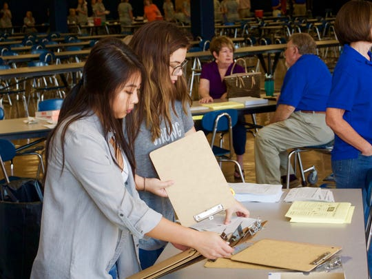 Volunteers prepare to register people to receive free flu shots at Farragut High School on Saturday, September 16 during a fundraiser to benefit the Empty Stocking Fund.