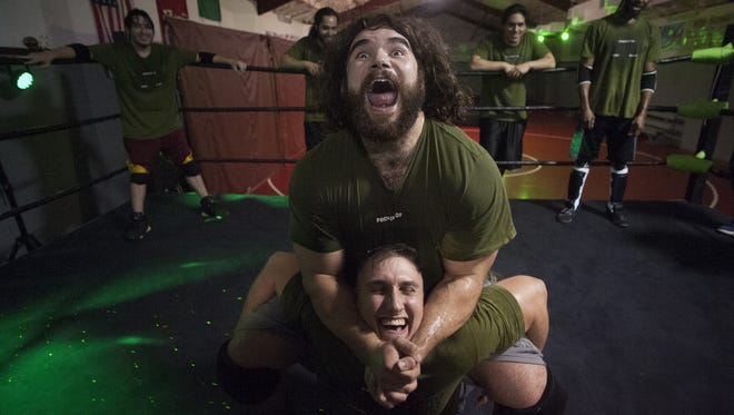 Wrestler Nick Comoroto (top) and Cody Vance perform wrestling moves during training  at The World Famous Monster Factory in Paulsboro.