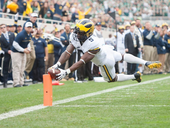 Michigan's Jabrill Peppers leaps into the end zone