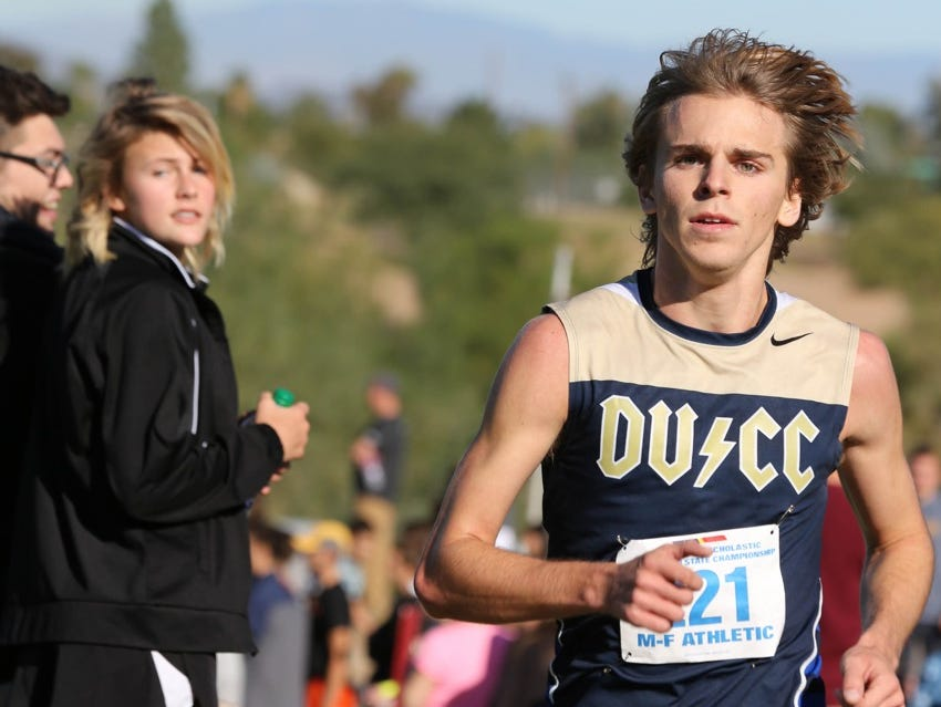 Desert Vista's DJ Harris won the Division I boys state cross country title on the 5K course at Phoenix's Cave Creek Golf Course in 15 minutes, 50.3 seconds.