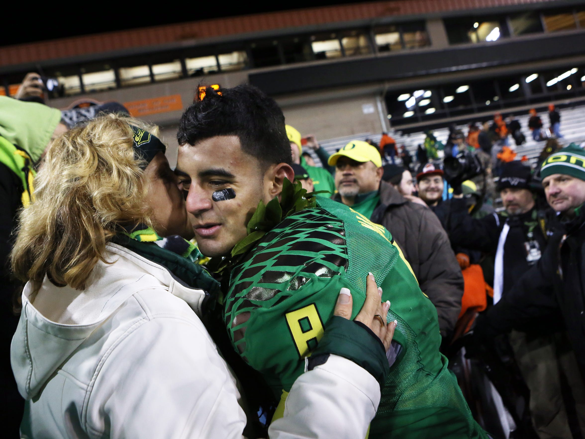 Marcus Mariota gets hugs and kisses from family members after the Ducks blew out the Beavers 47-19 in the annual Civil War game between Oregon and Oregon State in 2014 at Reser Stadium in Corvallis.