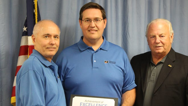 Senior Account Supervisor Jason Seibert (center) receives a Certificate of Excellence from Michael Evanish, manager of Pennsylvania Farm Bureau's MSC Business Services (left) and Louis Sallie, PFB's administrative secretary.