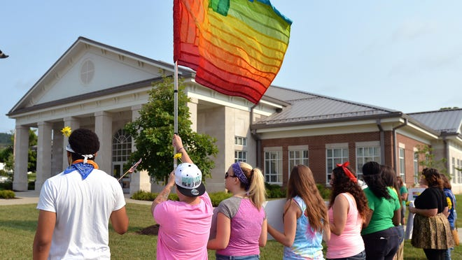 About a month ago, protesters demonstrated outside the Rowan County Judicial Center after County Clerk KimDavis refused to issue any marriage licenses — for straight or same-sex couples.