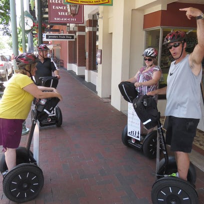 From left, Beverly Kron, Shannon Kron and Megan Kron, 18, listen to Emerald Coast Tours guide Rick Brown tell them about some of the historic buildings in the revitalized downtown Pensacola area during their Segway tour. The tours run from 10 a.m. to noon daily. Visit www.EmeraldCoastTours.net for more information.