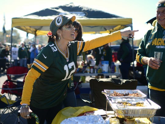 Jules Angel of Rancho Cucamonga, Calif. concocts a story attempting to convince her friends she just spotted Clay Matthews 'fixing his hair' in the parking lot before her first Packers game at Lambeau Field in Green Bay, Wis. on Sunday, Oct. 18, 2015. Angel has lived with Amyotrophic Lateral Sclerosis, also known as ALS or Lou Gehrig's Disease for seven years this month.