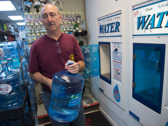 Tom Morrissey, of Palm City, filled two large water