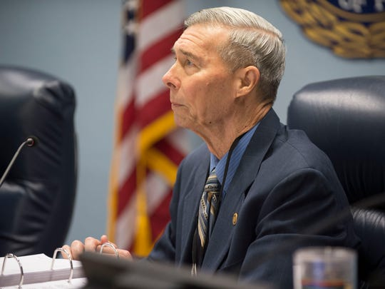 Commissioner Ed Fielding listens to public comment during the Martin County Commission meeting Tuesday, Dec. 12, 2017 at the Martin County Administration building in Stuart. Fielding and former commissioner Anne Scott were recently charged with violating public records law relating to a civil lawsuit with Lake Point Restoration, a rock quarry in western Martin County. Commissioner Sarah Heard pleaded not guilty to a noncriminal infraction related to violating state public records law.
