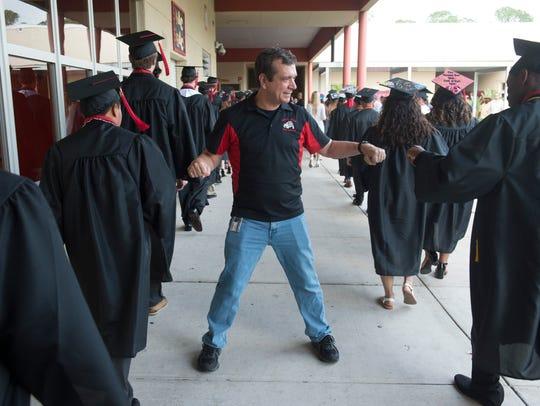 """""""Congratulations,"""" said Dr. Joe Schewmaker, a physics"""
