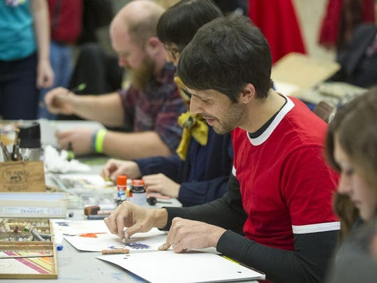 Artist Andy Fry is seen at work during the 2014 edition of the Monster Drawing Rally.