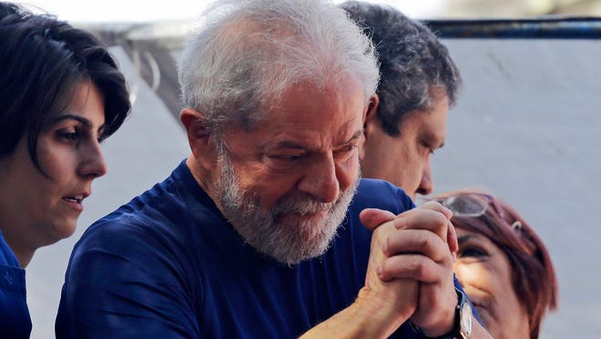 Former Brazilian President Luiz Inacio Lula da Silva was spending his first night in jail, a stunning fall from grace for a man who rose from nothing to lead Latin America's largest nation and later became engulfed in corruption allegations.