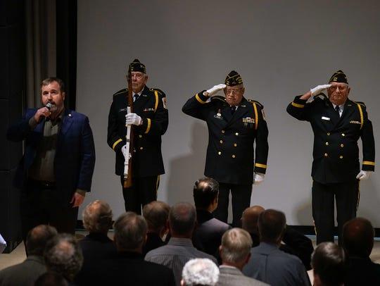 Corning employee Chris Cutter sings the National Anthem