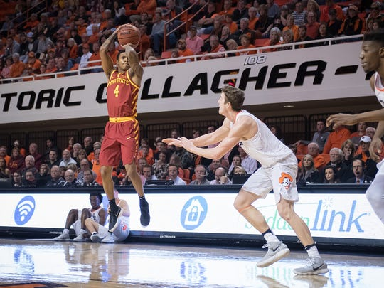 Iowa State guard Donovan Jackson takes a shot while being defended by Oklahoma State forward Mitchell Solomon (41) during their game at the Gallagher-Iba Arena in Stillwater, Oklahoma.