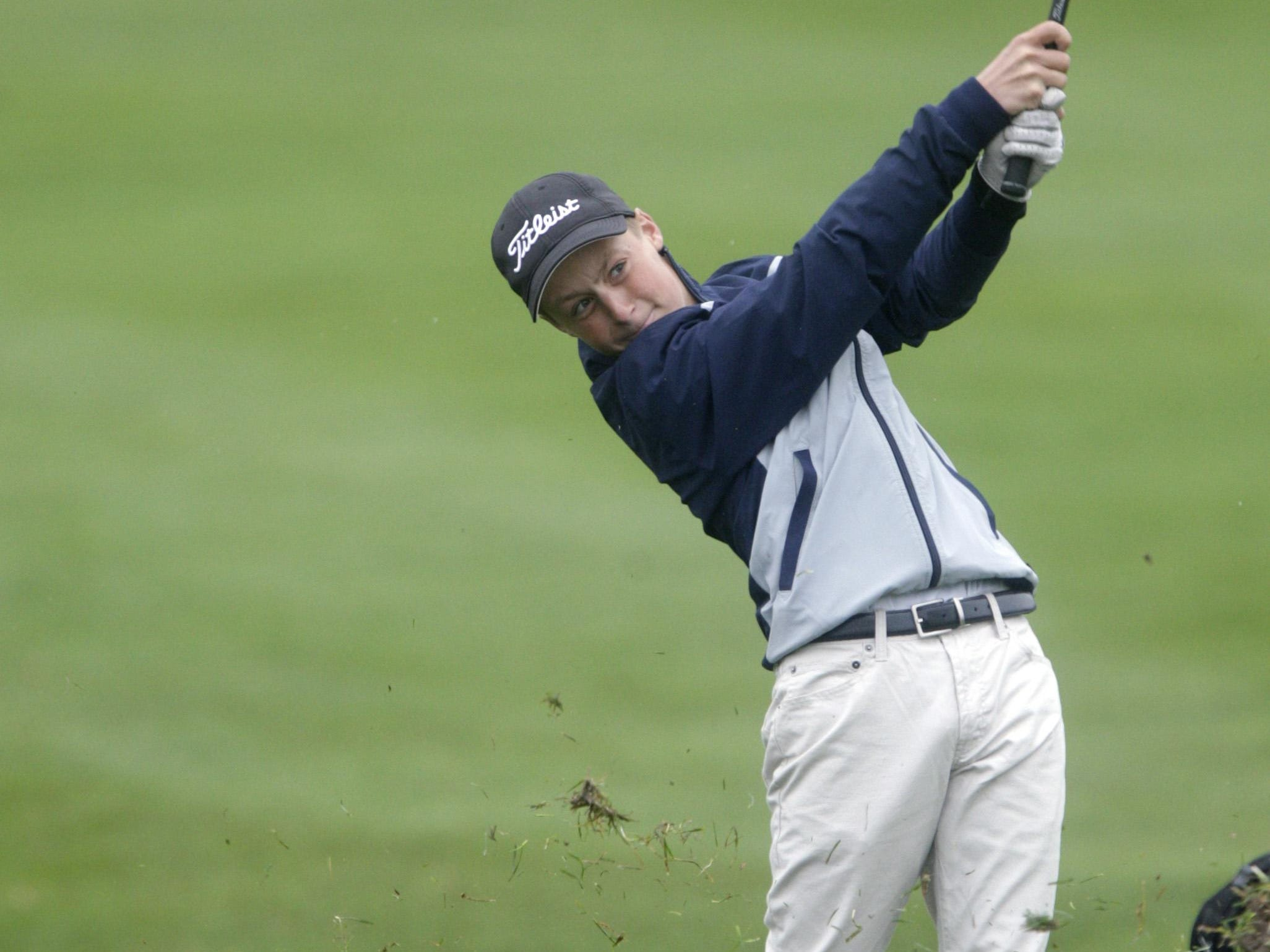 Luke Rezac of Sioux Falls Lincoln hits an approach shot during the opening round of the Class AA State Golf Tournament Monday at Meadowbrook Golf Course.