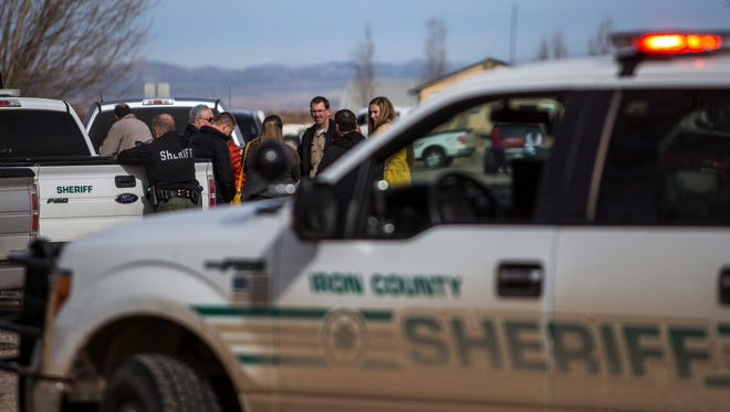 Sheriff's deputies wait outside an Enoch home in the aftermath of an armed standoff Tuesday morning, Jan. 19, 2016.