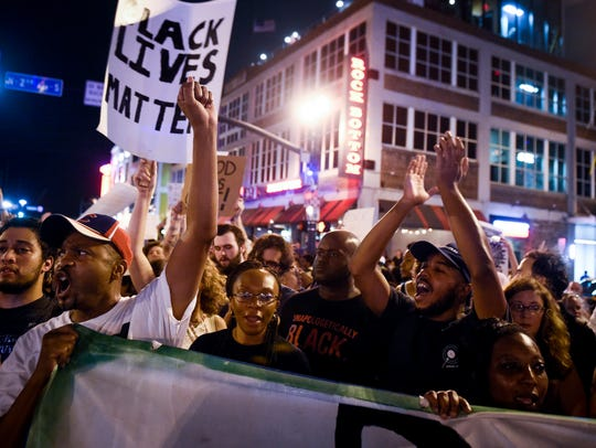Protesters march on Broadway during a protest, Friday,