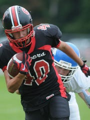Sevastopol's Quin Schram scores a touchdown in the first half against Three Lakes during Saturday's game at Sevastopol.