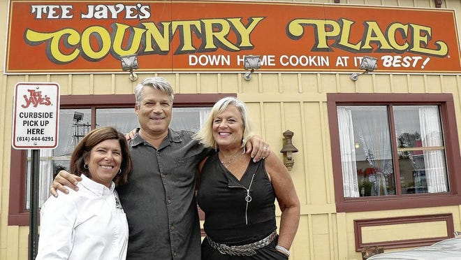 Tee Jaye's Country Place Restaurants is celebrating its 50th anniversary. Siblings (from left) Dayna Sokol Sandsten, Randy Sokol and Beverlee Sokol stand Aug. 31 in front the restaurant at 1385 Parsons Ave. in Columbus, the first location in the chain to open.