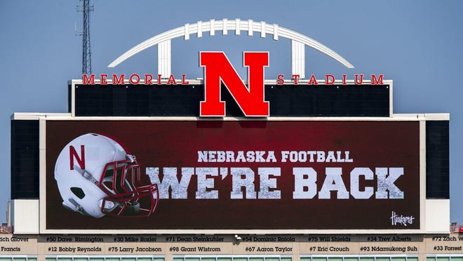 Memorial Stadium's north stadium video board projects the news of the return of Big Ten NCAA college football, Wednesday, Sept. 16, 2020, in Lincoln, Neb.