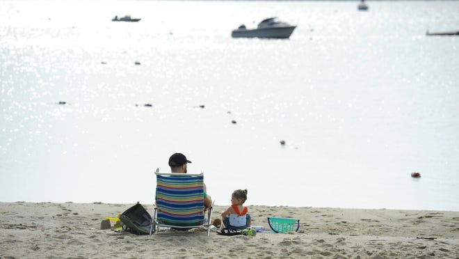 Two year old Ophelia Johnston and dad Travis took advantage of an early wake-up to watch the rising sun on the last day of spring and play in the sand at Veteran's Beach in Hyannis.