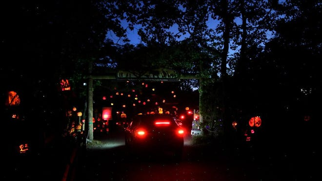 Cars work their way through the pumpkin displays at the drive-through Jack-O-Lantern Spectacular Thursday evening at Roger Williams Park Zoo.