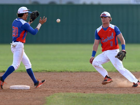 Central's Brock Martin tosses the ball to teammate Daniel Madrid to get a Belton runner out at second base on Tuesday, March 28, 2017.