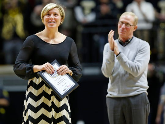 Purdue swimmer Emily Fogle is presented with the Haier Achievement Award by Athletic Director Morgan Burke during the Purdue men's basketball game with Penn State Wednesday, January 13, 2016, at Mackey Arena. The Haier Achievement Award recognizes achievement beyond sports. Fogle has battled back from injury, an eating disorder and even the death of her mother to be successful both in the pool and in the classroom.