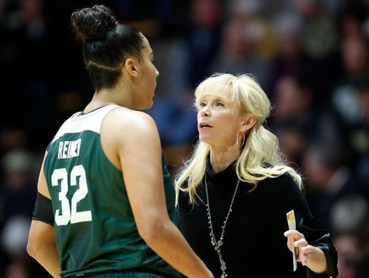 Michigan State head coach Suzy Merchant talks with