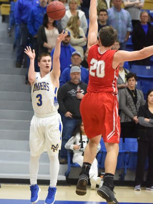 Mountain Home's Hunter Beshears shoots over a Vilonia defender during a recent home game.