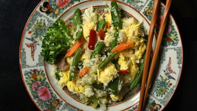 "Cauliflower ""stir-fried rice"" makes a tasty Asian-inspired combination."
