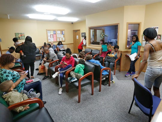 Applicants line up to apply for Section 8 vouchers Wednesday, May 6, 2015, at Lafayette Housing Authority, 100 Executive Drive, Lafayette. The wait list for Section 8 vouchers keeps growing, surpassing the cutoff point of 500 people. Executive Director Michelle Reynolds doesn't want to close the wait list, however, because it gives people hope.