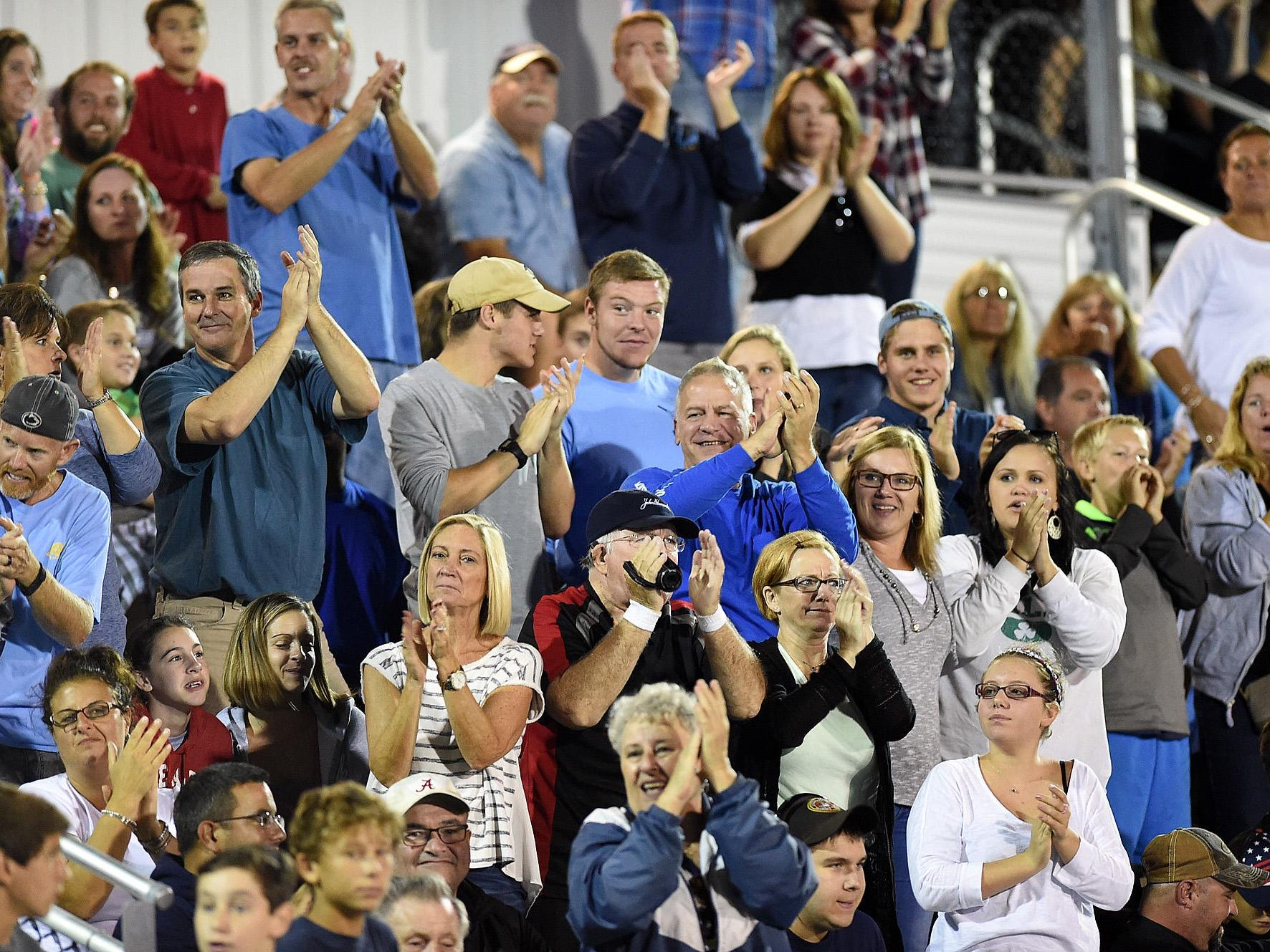 Fans react as Cape scores during their loss against Oakdale. Fans react as Cape scores as Cape Henlopen High School Varsity Football (yellow) opened their home season with a loss to Oakdale HS from Fredrick, Md 12-48 at Legends Field at the school near Lewes on Friday September 18th.