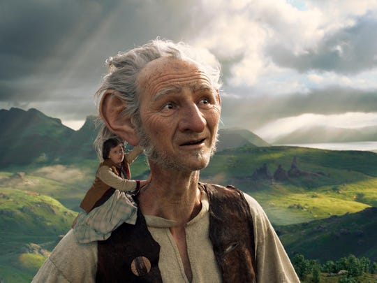 """This image released by Disney shows Ruby Barnhill and the Big Friendly Giant from Giant Country, voiced by Mark Rylance, in a scene from""""The BFG."""" (Disney via AP)"""