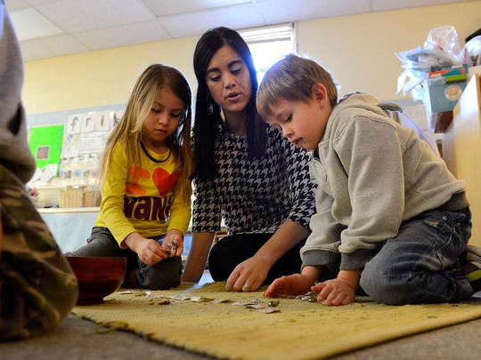 Katie Dama Jaskolski works with students on counting by matching symbols to quantity with polished rocks in her Wexford Montessori School kindergarten and preschool classroom Tuesday, March 24, 2015. Jaskolski suffers from two rare disorders - Ehlers-Danlos syndrome and postural orthostatic tachycardia syndrome - and founded the Life as a Zebra Foundation to help and support those with hard-to-diagnose diseases.