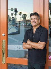 Daniel Gore, the current operator of Oscar's, is photographed by the front door. Gore is one of two businessmen who claim rightful ownership of the beloved restaurant.