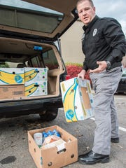 The food that the Black Mountain Police Department gave to needy residents Nov. 21 was collected throughout the community, chief Shawn Freeman said.