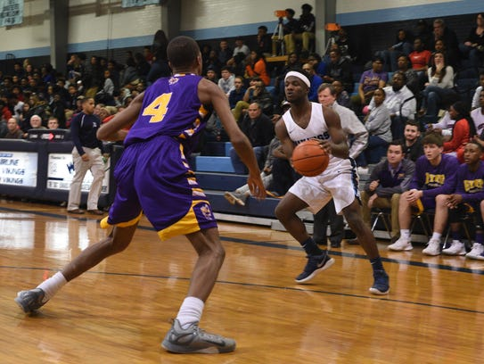 Airline's Fred Lemons prepares to drive against Byrd's Joseph Wiggins during Tuesday's game at Airline.