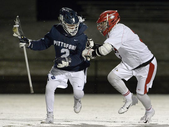 Pittsford's John Mozrall, left, is defended by Penfield's Jason Berardicurti during a regular season game played at Penfield High School, Thursday, April 19, 2018. Mozrall is Pittsford's leader in goals (27), assists (13) and points (40).