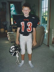 Cooper Rush as a child on Charlotte Junior Orioles football team, a nonprofit youth sports league.