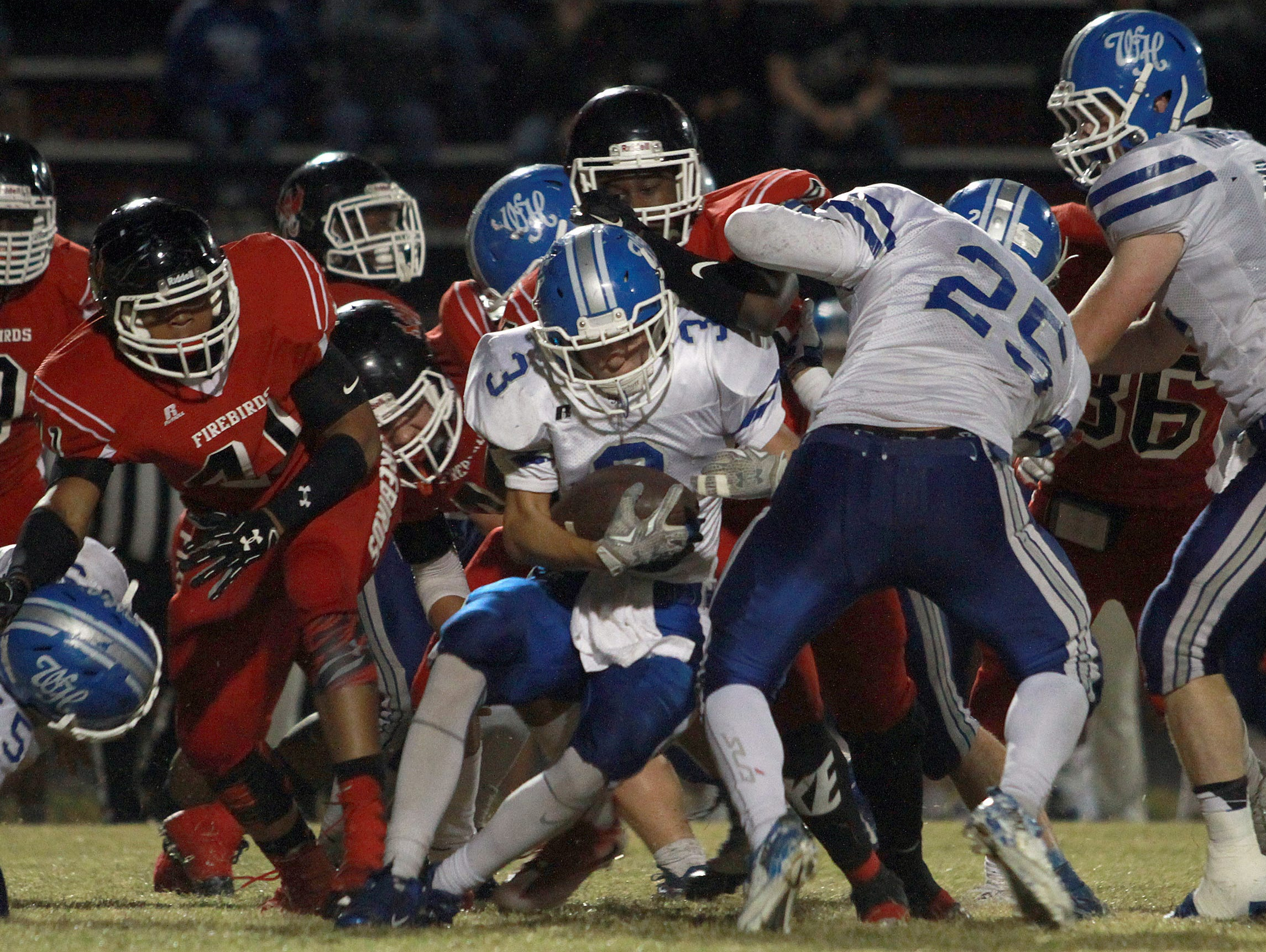 White House's Carter Hunt tries rushing up the middle during a loss to Pearl-Cohn on Friday.