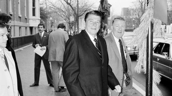 President-elect Ronald Reagan and his transition team leader Edwin Meese leave the Blair House Dec. 10, 1980.