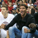 Damion Lee and Mangok Mathiang encouraged their teammates while sitting on the bench during the game against Boston College. The two were often vocal when cheering.  Feb. 6, 2016