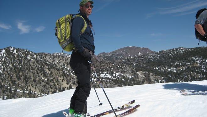 Reno Gazette Journal and Sierra Outdoors journalist Benjamin Spillman on assignment in the Sierra Nevada backcountry near Lake Tahoe.