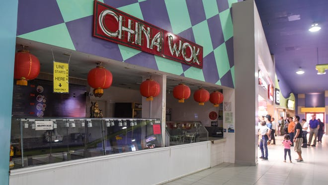 In this file photo, China Wok vendor stall can be seen closed on Wednesday, Oct. 11, 2017, after a notice of closure was issued to the vendor at the Guam Premier Outlets food court.