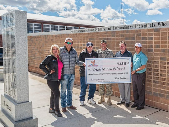 Proceeds from the Eagles Landing Veterans Charity Golf Tourney were presented to the Utah National Guard: (from left) Katy Yardley; Mark J. Yardley, owner of Eagles Landing; Ray Yardley; Kiley Eyre, Utah National Guard member; and Paul Raymond and Mike Miller, both of the board of directors for the Utah National Guard.